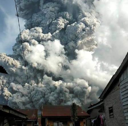 Indonesia warns of further eruptions after volcano spews ash