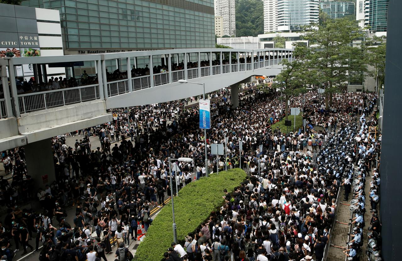 Protesters gather outside the entrance to the Legislative Council building in Hong Kong on June 12. Credit: Thomas Peter/Reuters