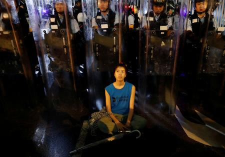 UPDATE 8-Tens of thousands of protesters force delay in Hong Kong extradition bill debate