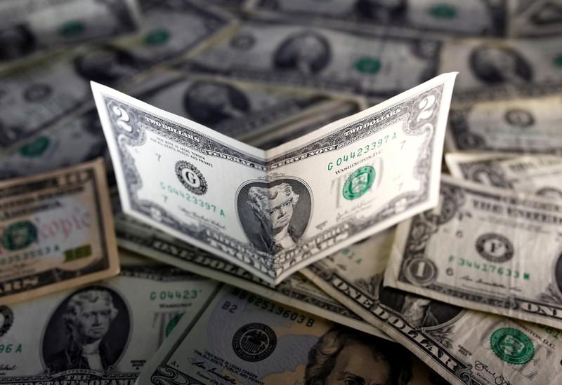 Dollar gains on solid retail sales, before Fed meeting
