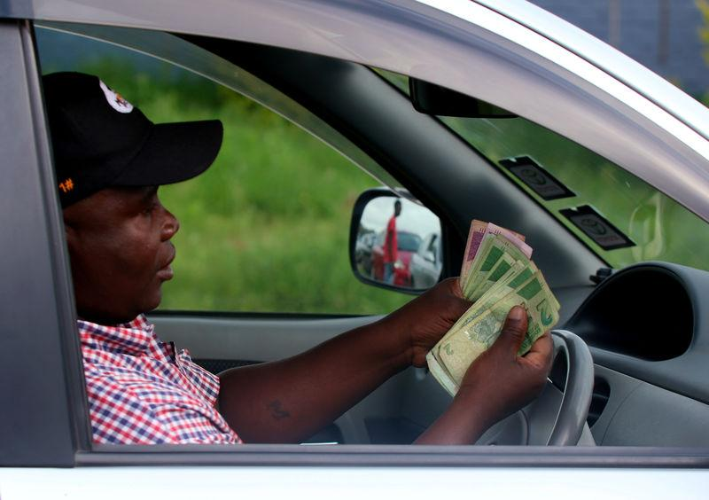 Zimbabwe's currency hits new low, firms demanding payment in U.S....