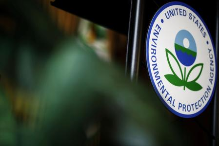 U.S. EPA air chief under ethics scrutiny resigns