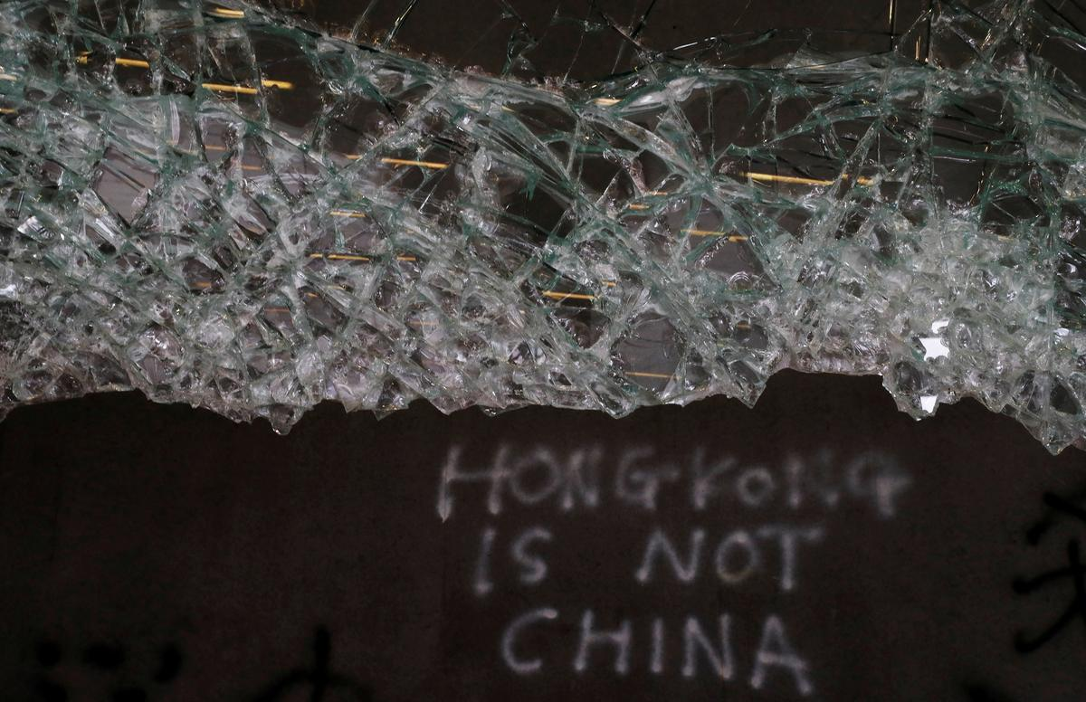 China condemns violent Hong Kong protests as 'undisguised challenge