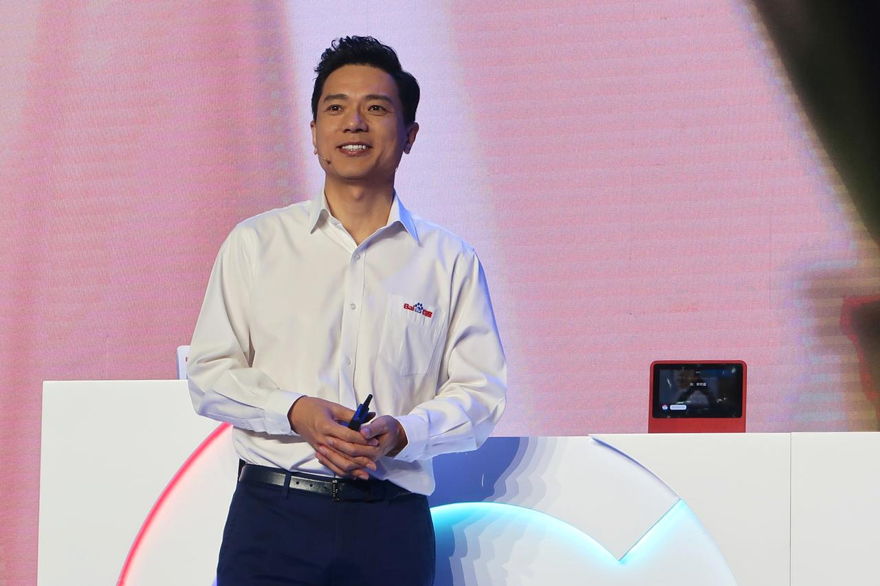 Difficulties on the road to AI': man pours water on Baidu chief at