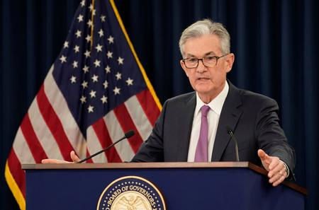 Fed's Powell bolsters rate cut view on trade, global growth concerns