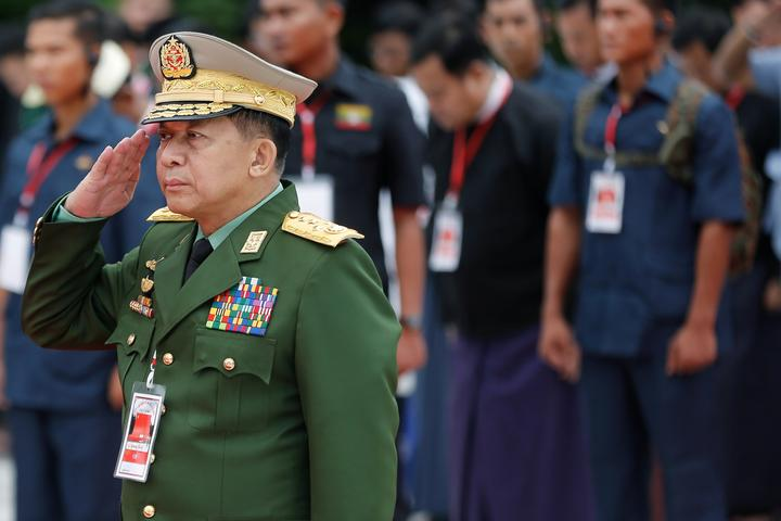 Myanmar's Commander in Chief Senior General Min Aung Hlaing salutes as he...
