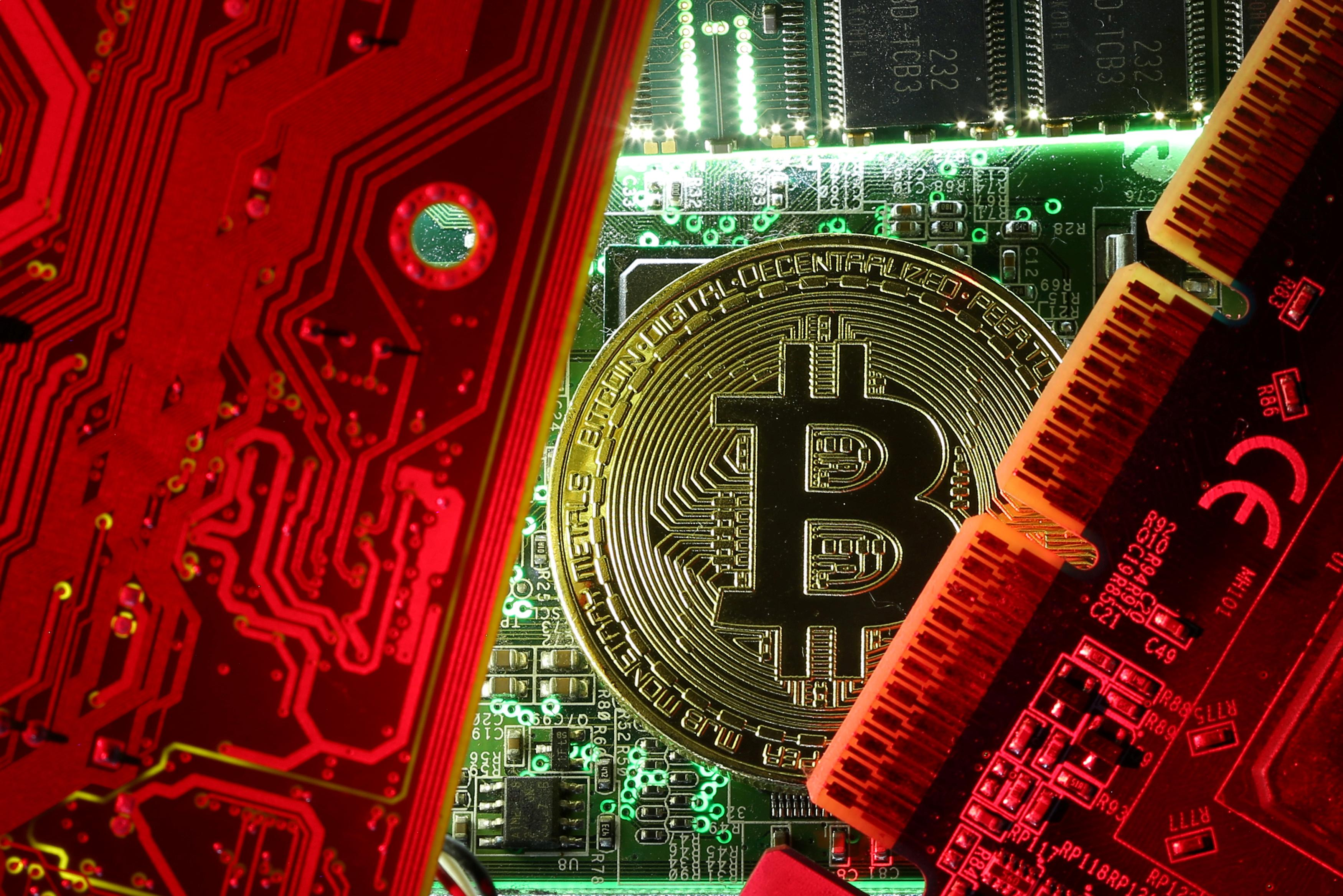 A copy of bitcoin standing on PC motherboard is seen in this illustration picture, October 26, 2017. Dado Ruvic