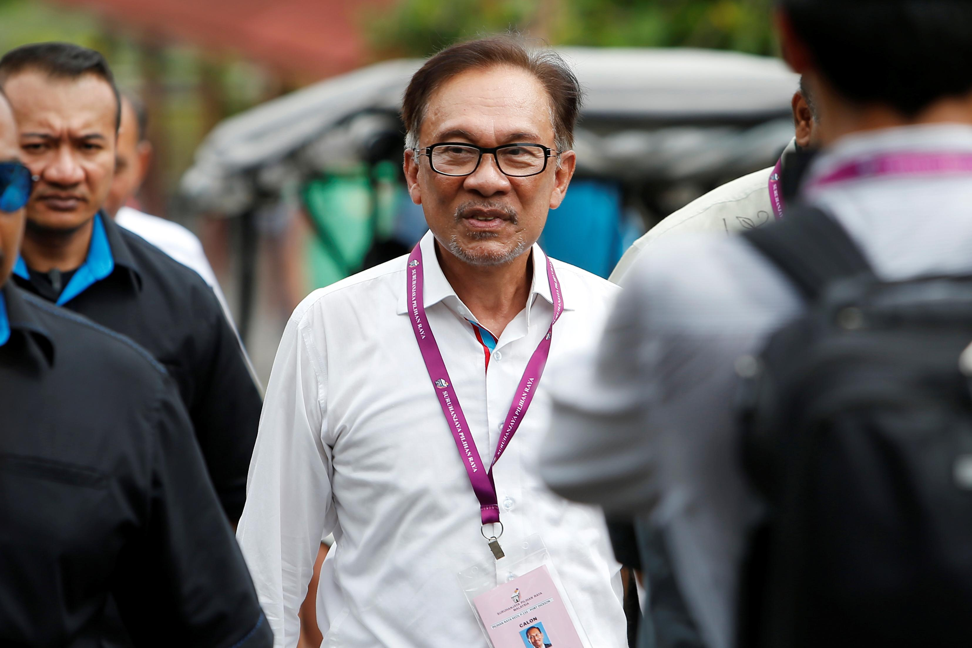 Malaysian police say political leader behind gay sex tape allegations