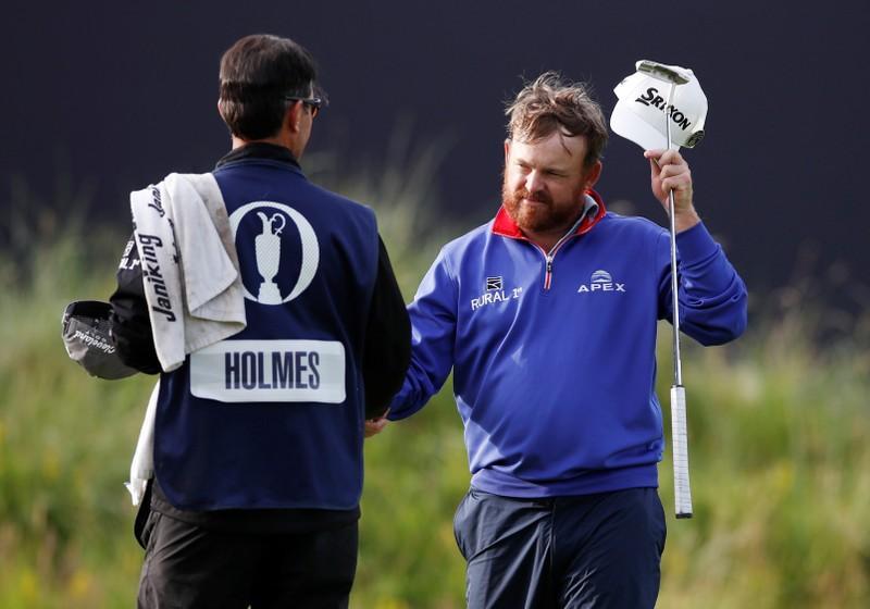 Holmes donne le ton alors que McIlroy perd 79 cartes lors de l'Open