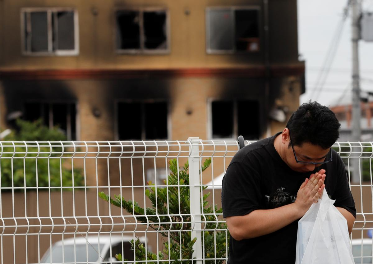 Japan officials hunt for reasons behind devastating fire that killed 34