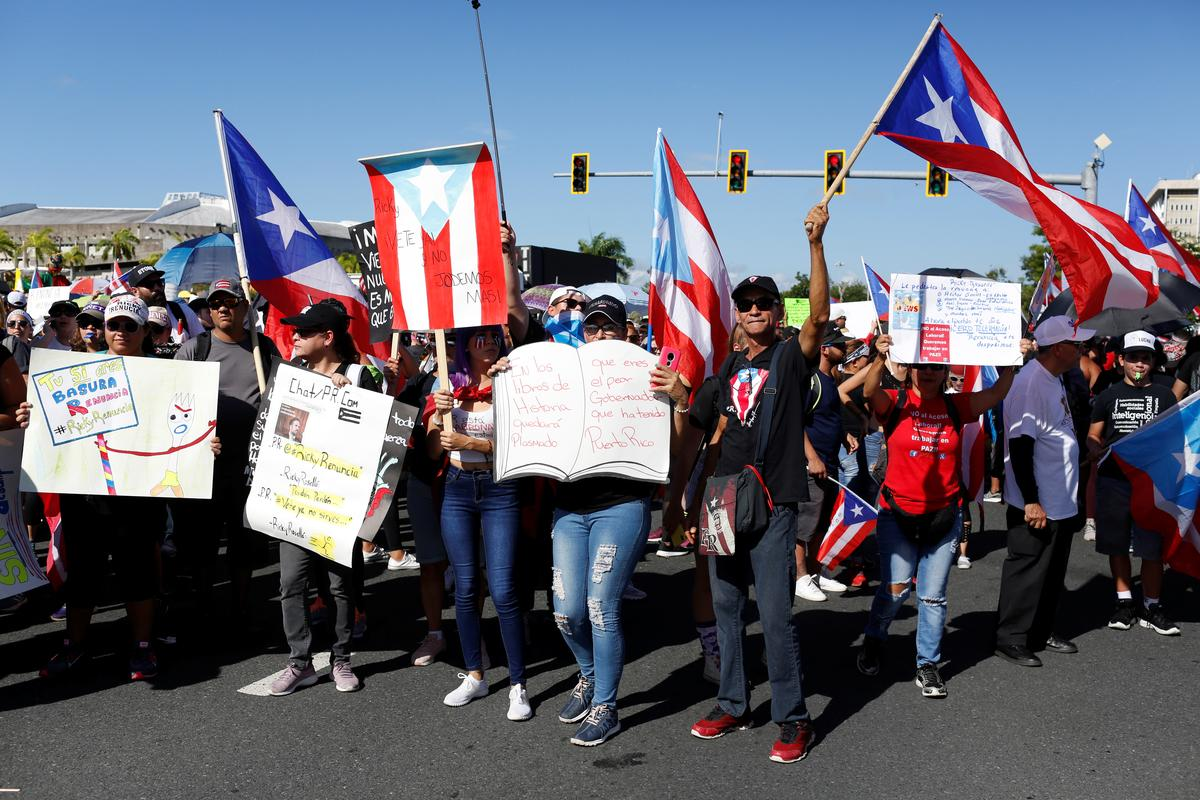 Thousands jam San Juan streets to demand Puerto Rico's governor resign