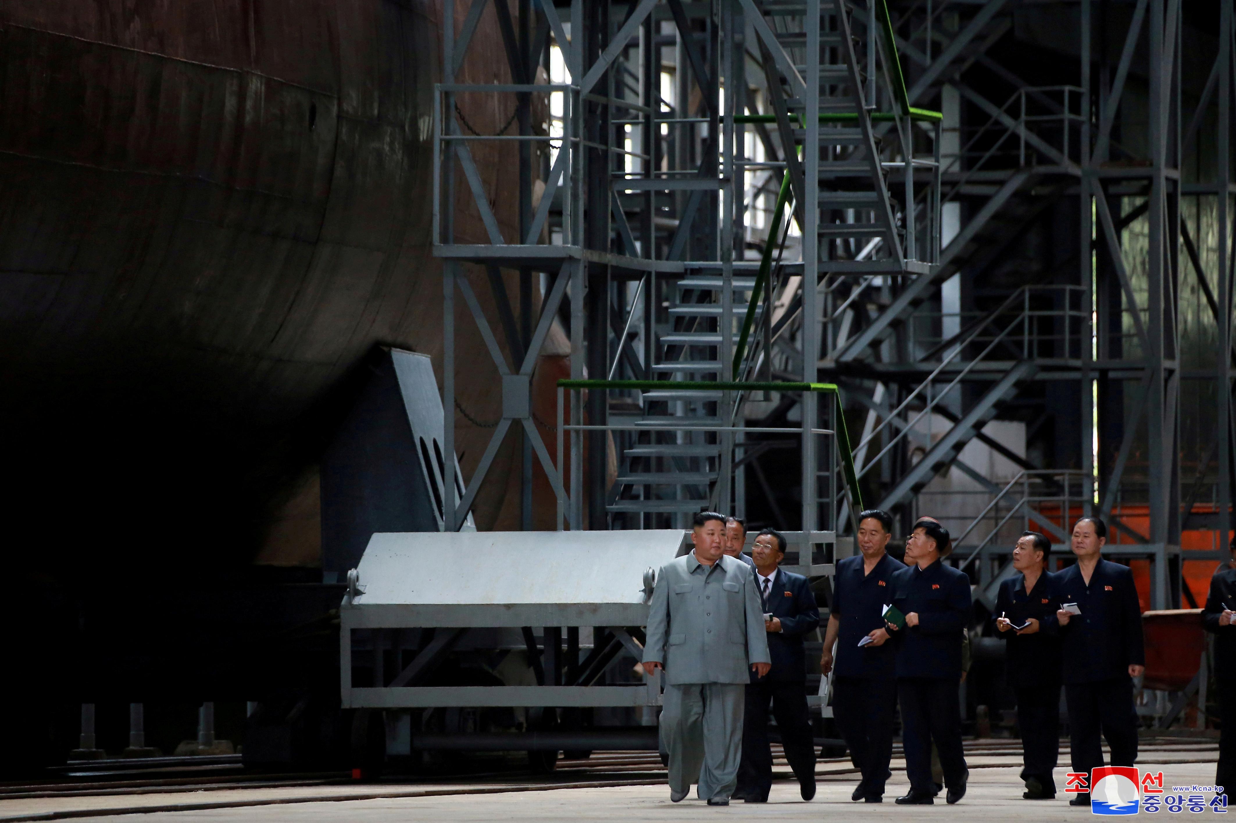 North Korea's Kim inspects new submarine, signals possible