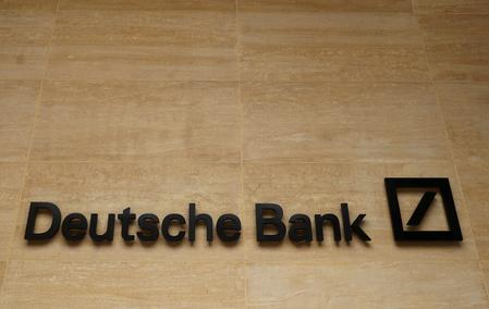 Deutsche Bank stumbles to big loss on road to reinvention