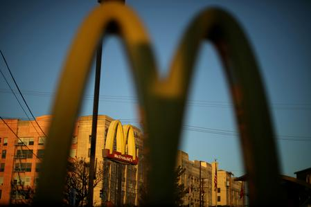 McDonald's beats sales forecast on new deals, store revamp