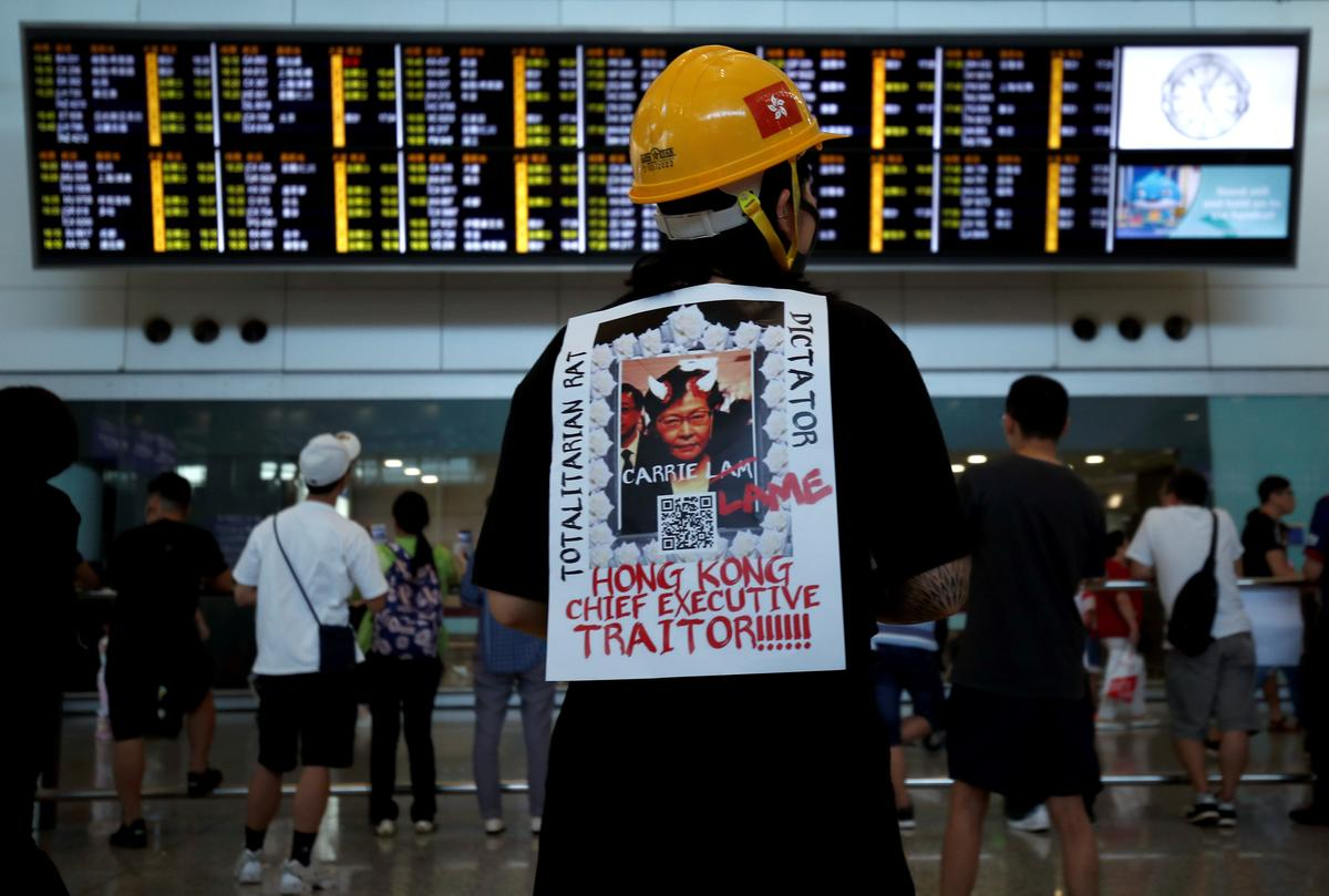 Protesters flock to Hong Kong's airport as political crisis simmers on