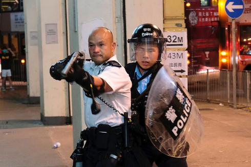 New protests erupt after Hong Kong activists charged with rioting
