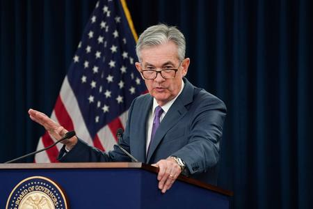 Fed cuts rates, signals it may not need to do more