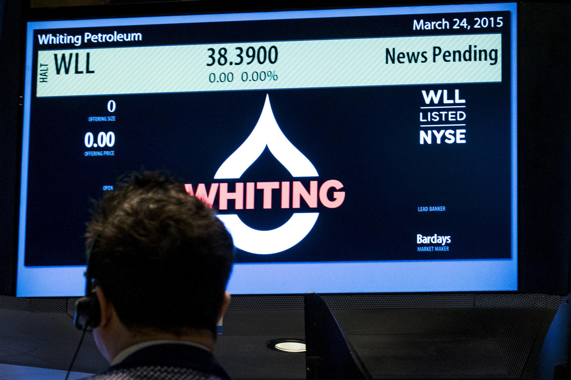 Whiting Petroleum posts surprise quarterly loss, cuts 33% workforce