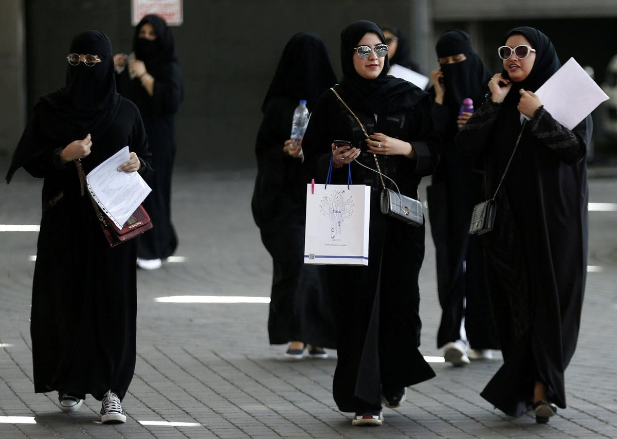 Saudi Arabia lifts travel restrictions on women, grants them...