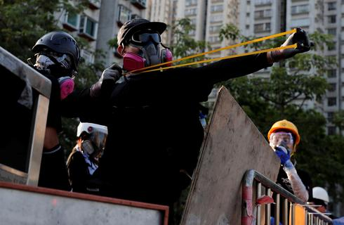 Police battle protesters as strike cripples Hong Kong