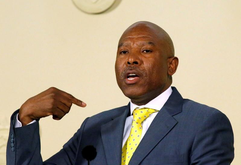 South Africa's central bank governor says will go to war to protect...