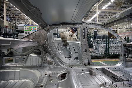 Exclusive: PSA, Dongfeng to drop two China auto plants, halve workforce - document
