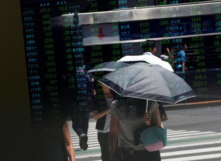 Asian shares turn lower on Sino-U.S. trade, recession worries