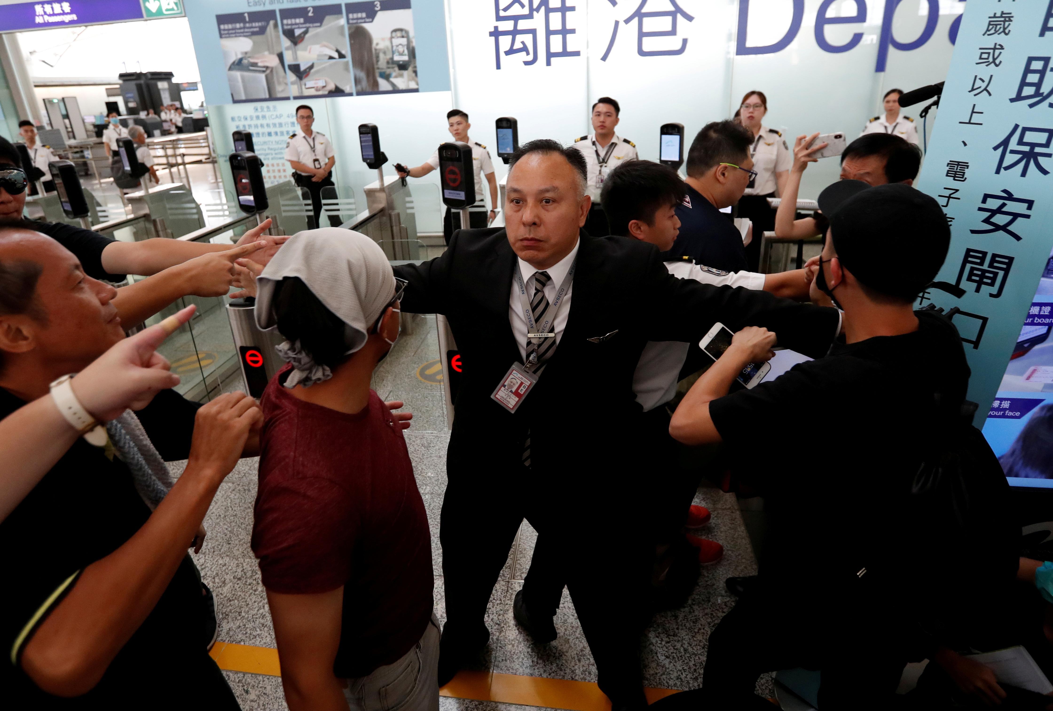Clashes at Hong Kong airport; U.N. urges restraint over protests