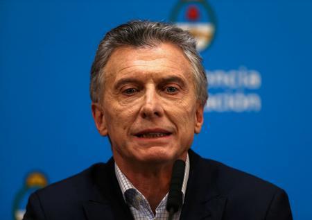UPDATE 7-With economic storm breaking, Argentina's Macri announces relief measures