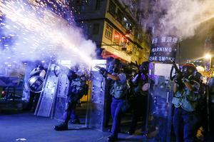 Hong Kong police fire tear gas in Sham Shui Po streets
