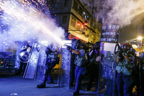 Hong Kong police fire tear gas in Sham Shui Po streets