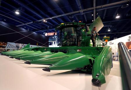 Deere to slash costs after trade war hits earnings