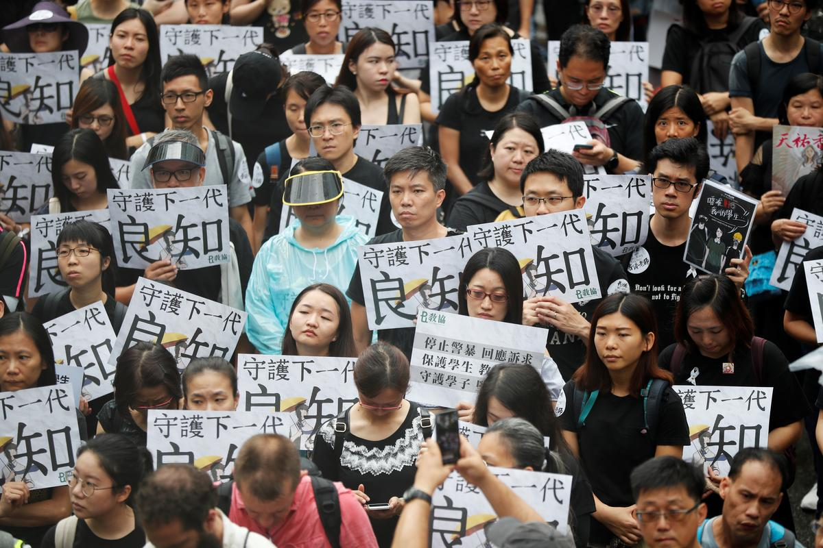 Hong Kongers rally against government on night of storms