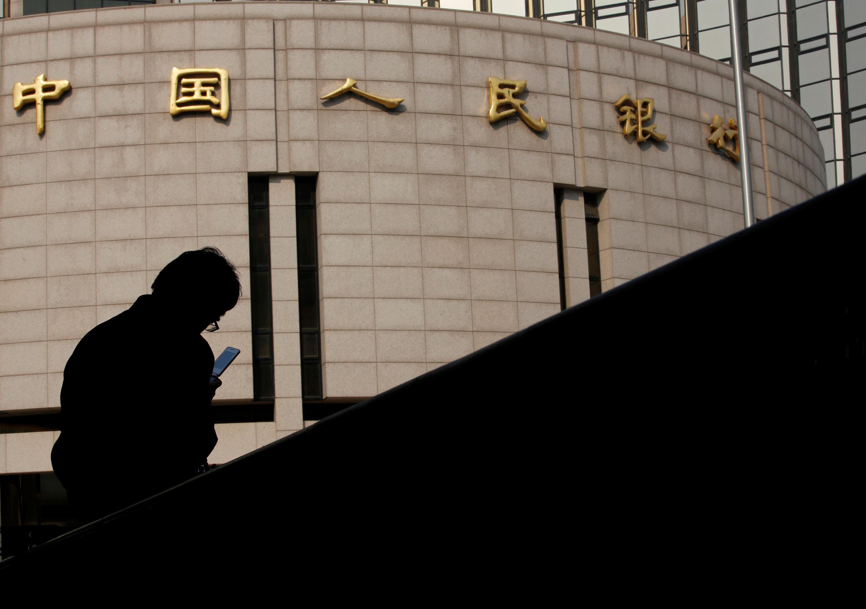 China to base new lending benchmark on medium-term rates; shares...