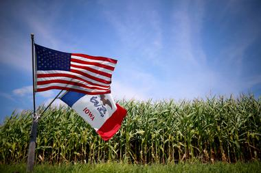 FILE PHOTO: File photo of a U.S. and Iowa state flag are seen next to a...