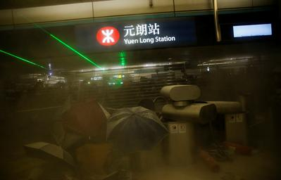 Hong Kongers protest at site of suspected triad attacks