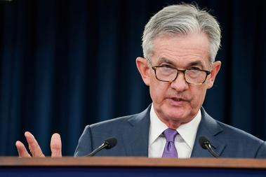 FILE PHOTO: Federal Reserve Chair Jerome Powell holds a news conference in...