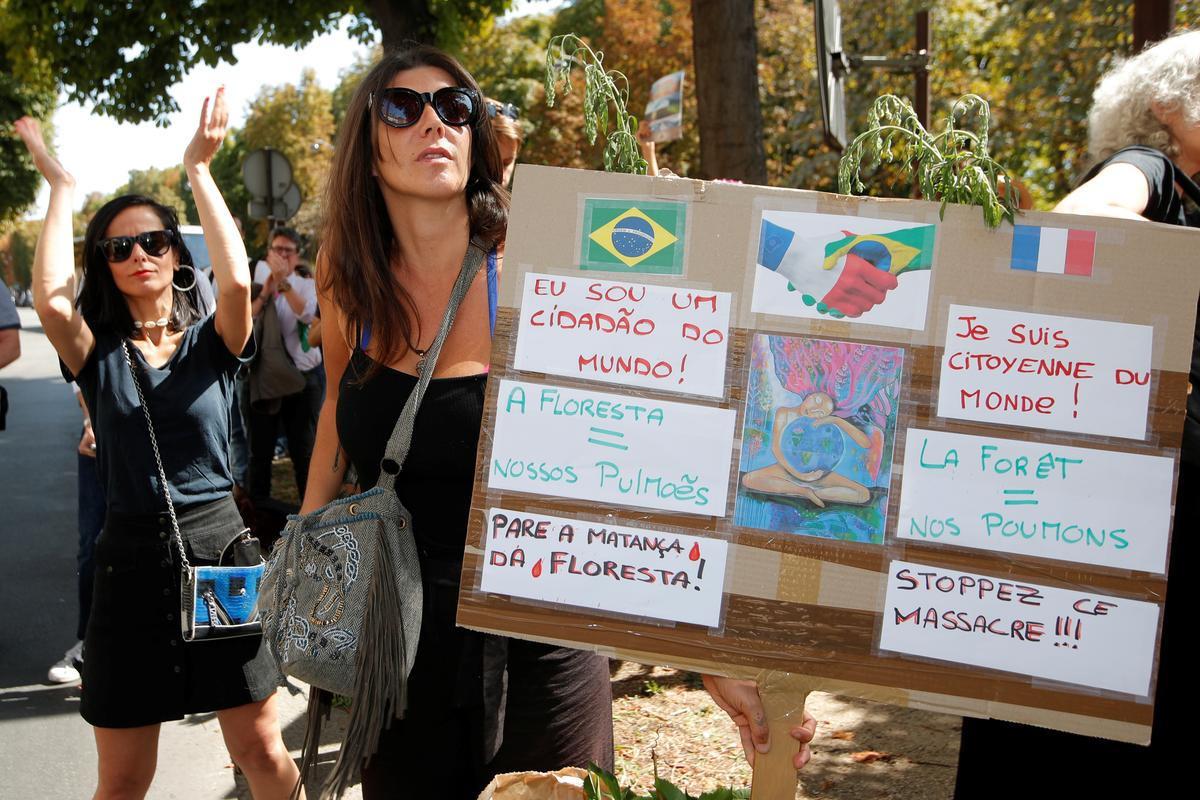Climate activists demonstrate outside Brazil embassies in Paris and London