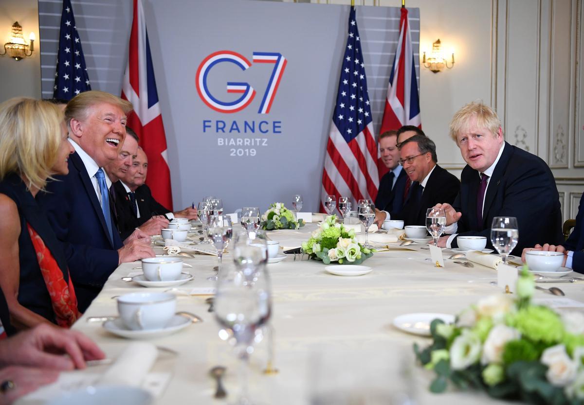 Trump skilder 'n beeld van eenheid op die stekelrige G7-beraad