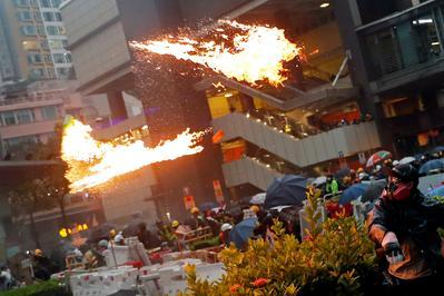 Hong Kong police run battles with protesters