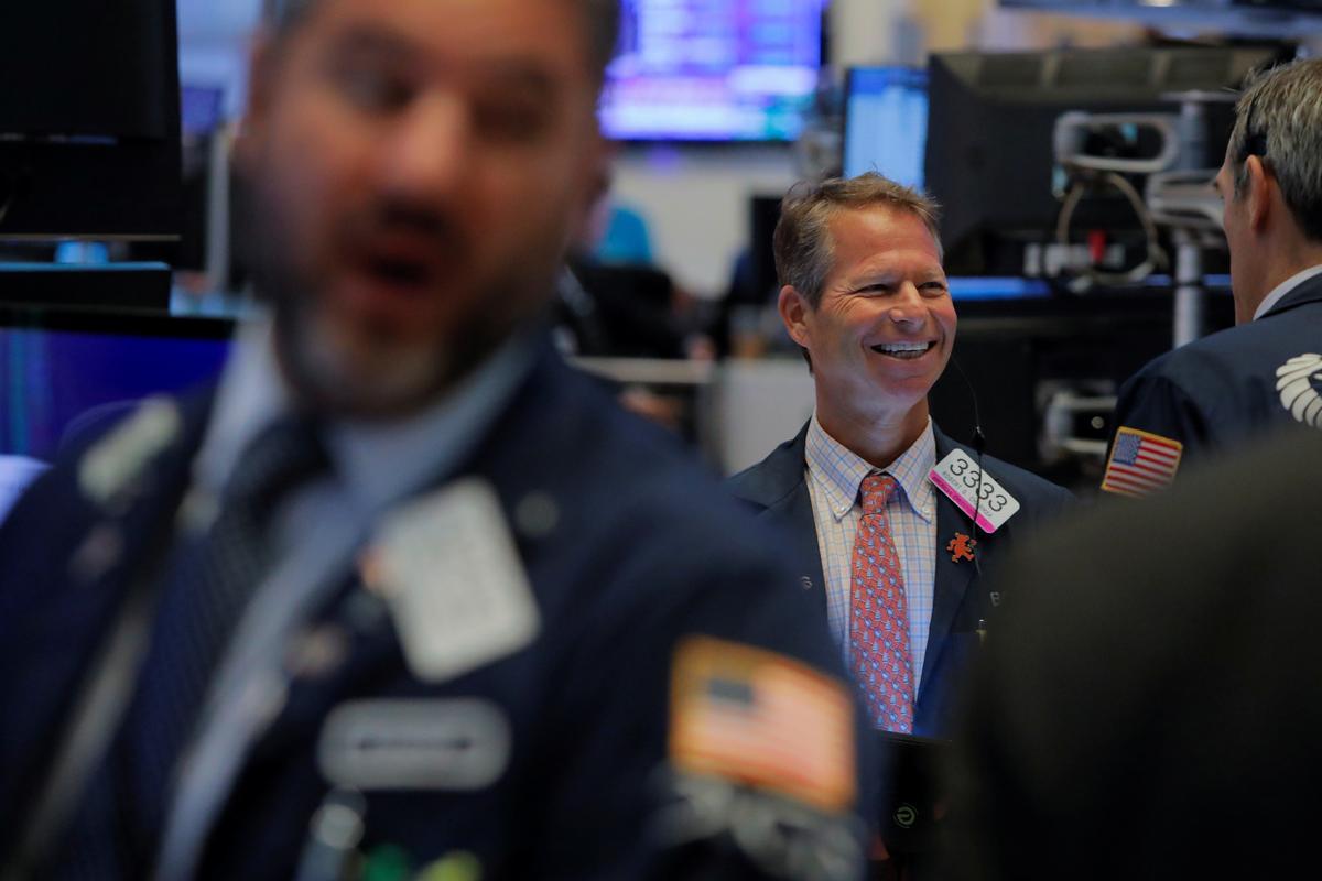 Stocks, dollar rise as U.S.-China trade rhetoric softens