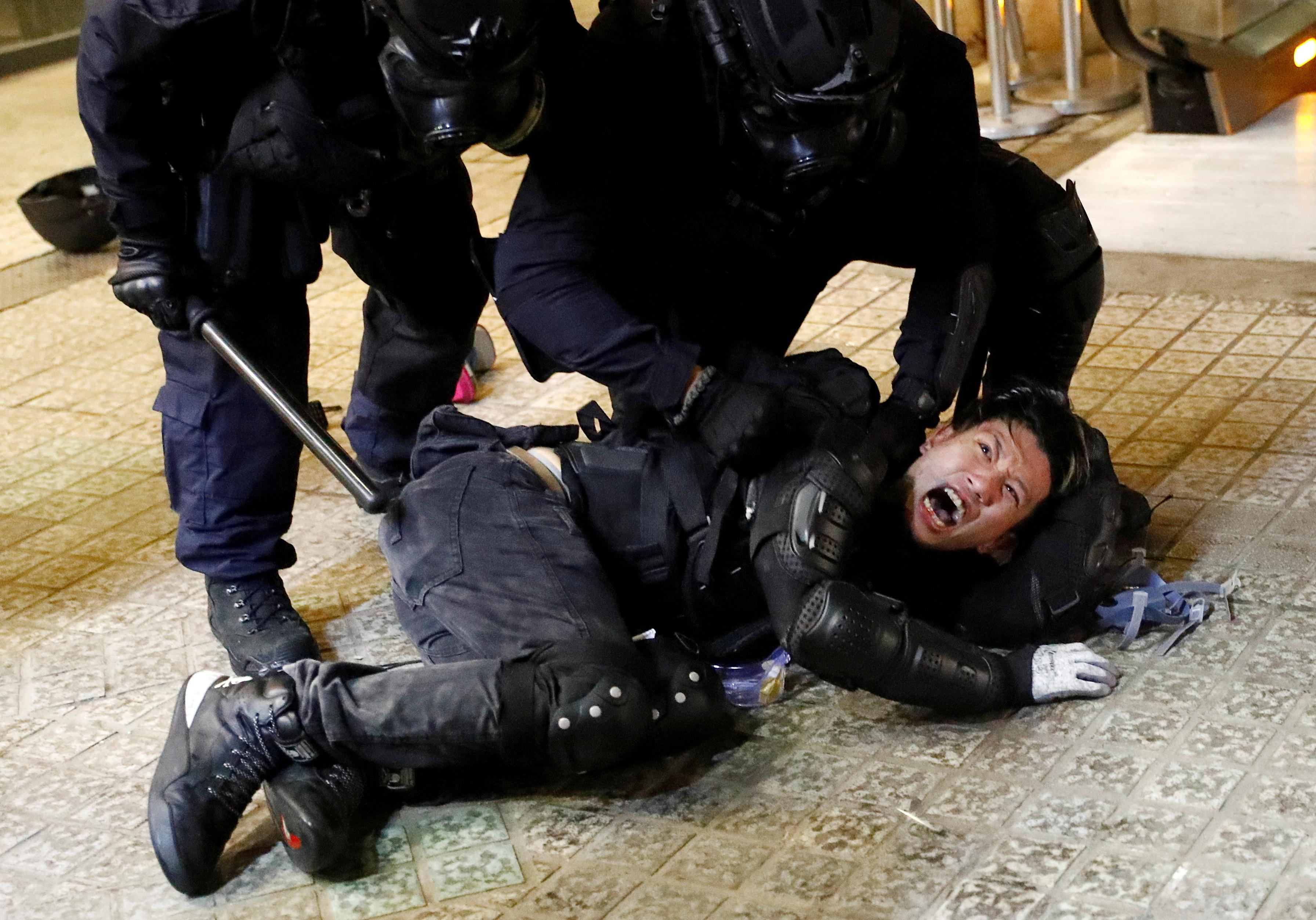 Hong Kong commercial centers paralyzed as protesters, police...