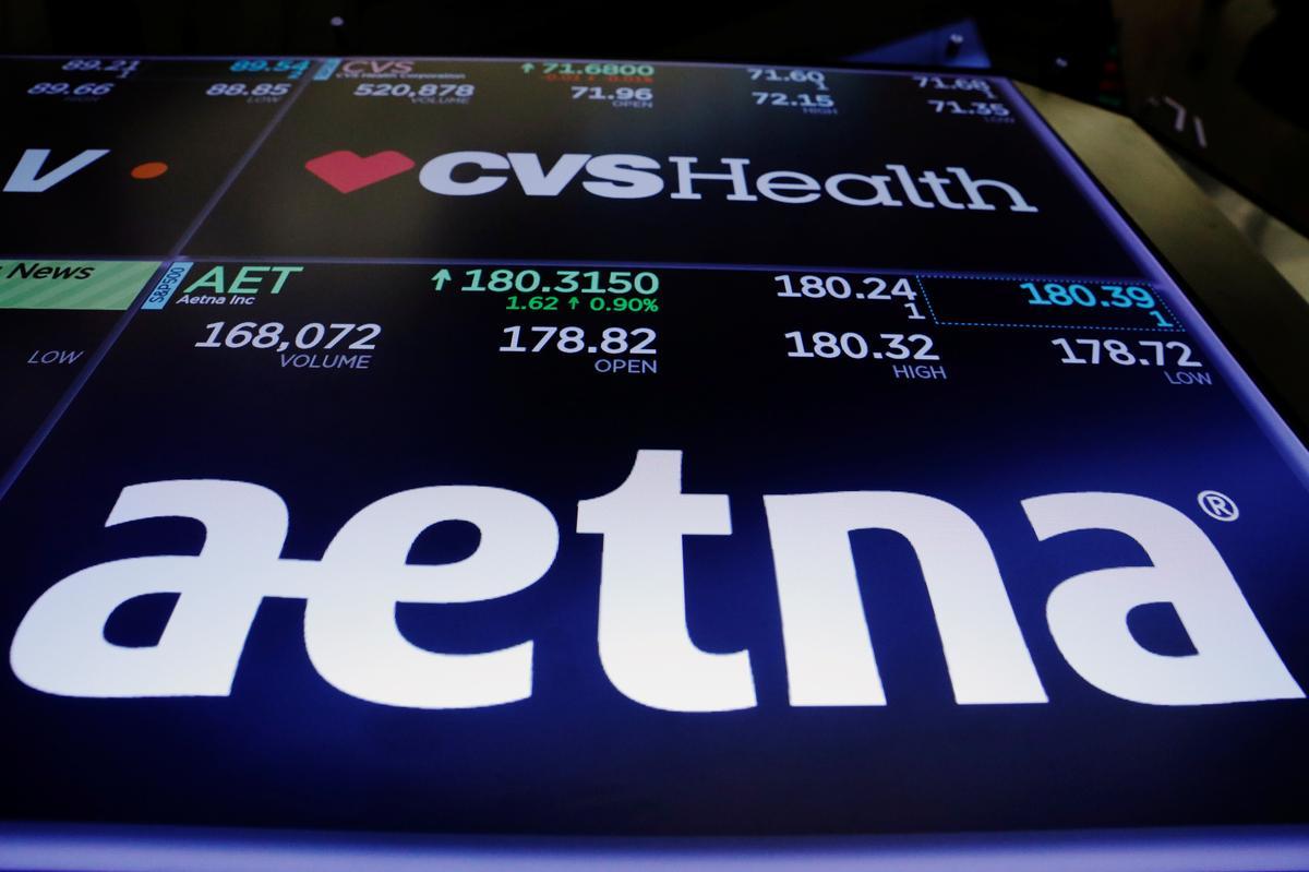 Image result for U.S. Judge Approves CVS Purchase of Insurer Aetna images