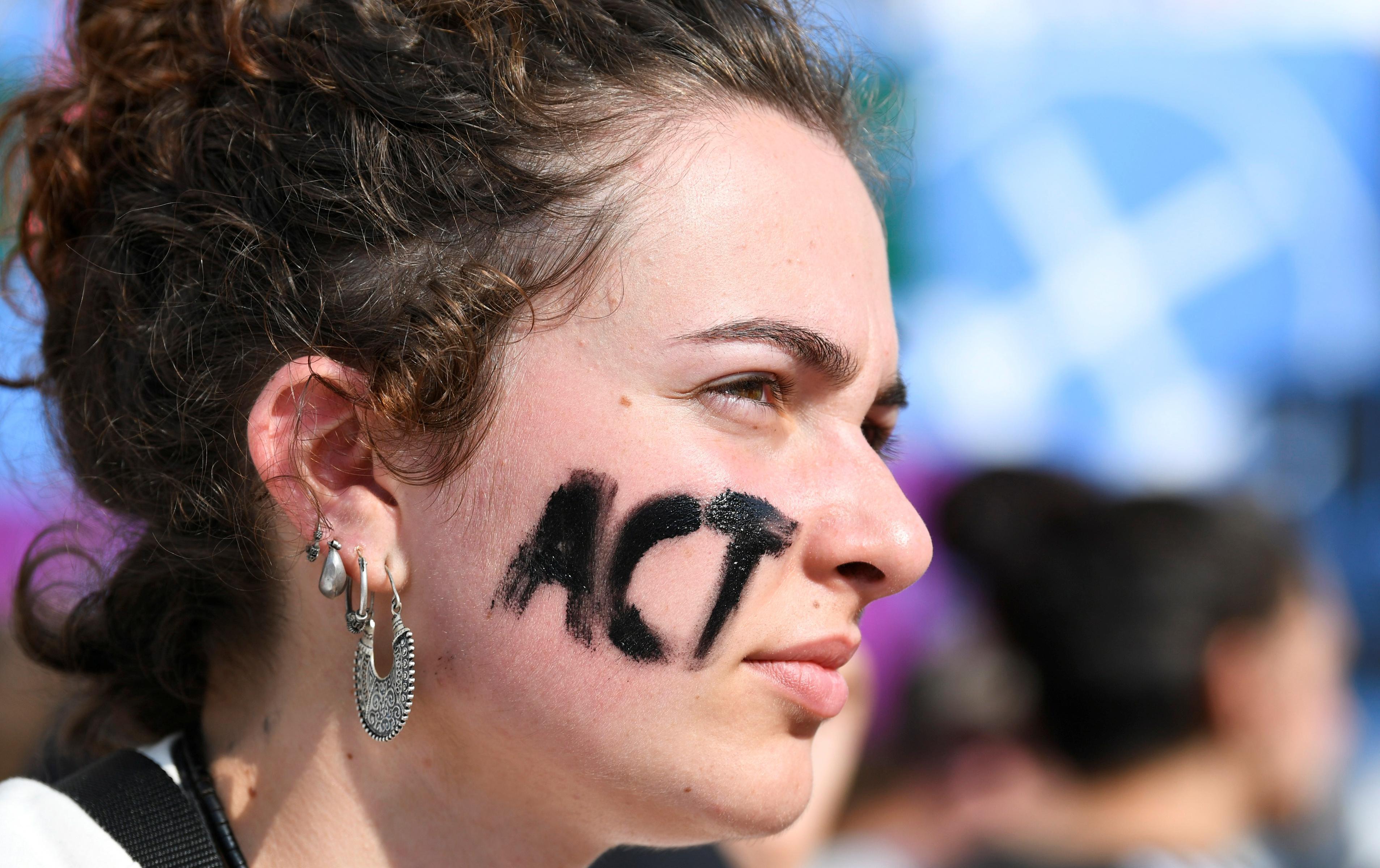 Climate change activists storm red carpet at Venice Film Festival