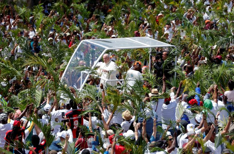 Pope Francis arrives in Papamobile to celebrate a mass at the monument to Mary, Queen of Peace in Port Louis, Mauritius. REUTERS/Yara Nardi