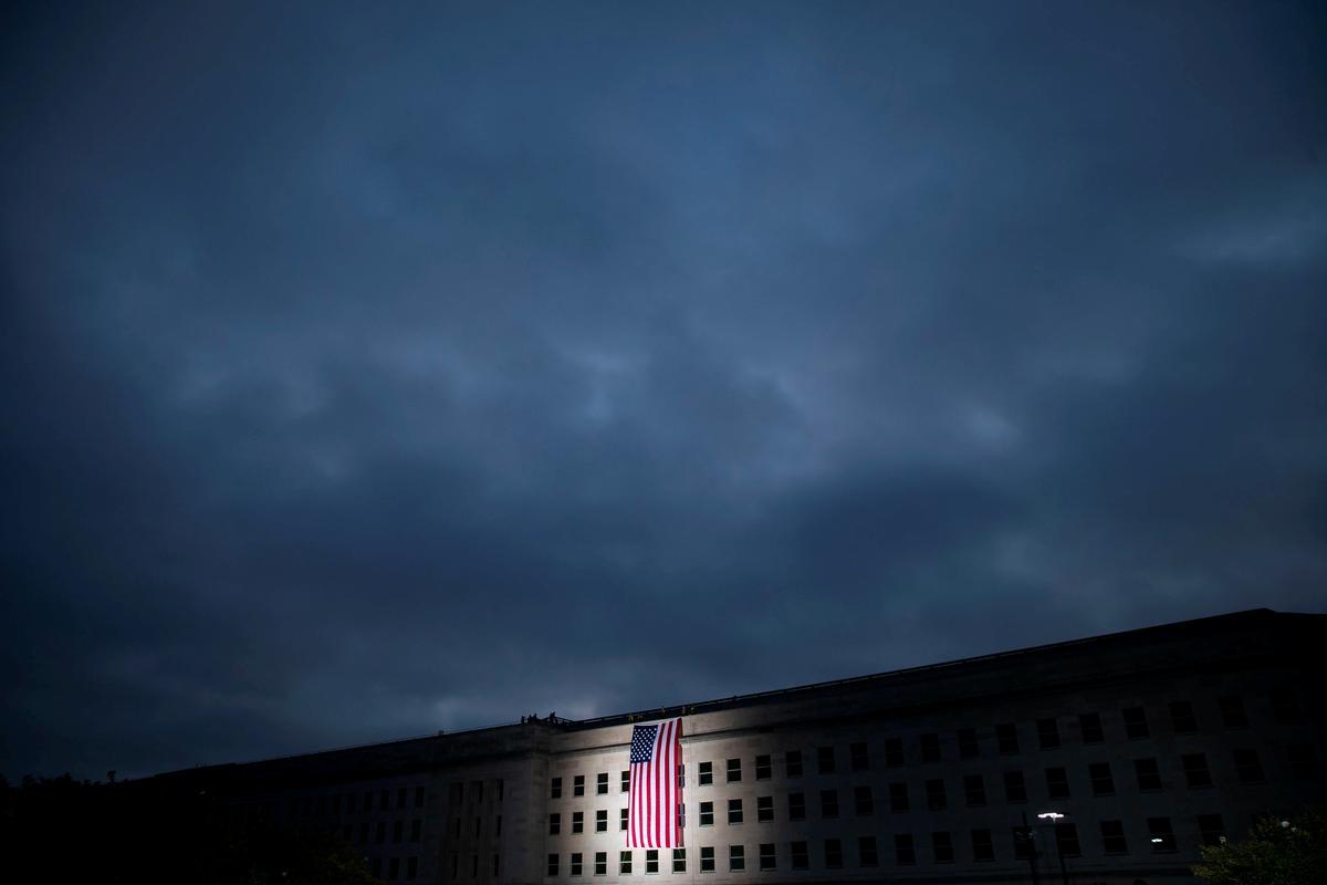 Amerikaanse ministerie van justisie om die naam van die skaduryke figuur vry te laat in die saak van 11/11