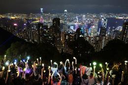 Lantern-waving Hong Kong protesters take to hills