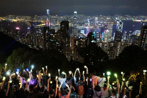 Lantern-waving Hong Kong protesters take to hills