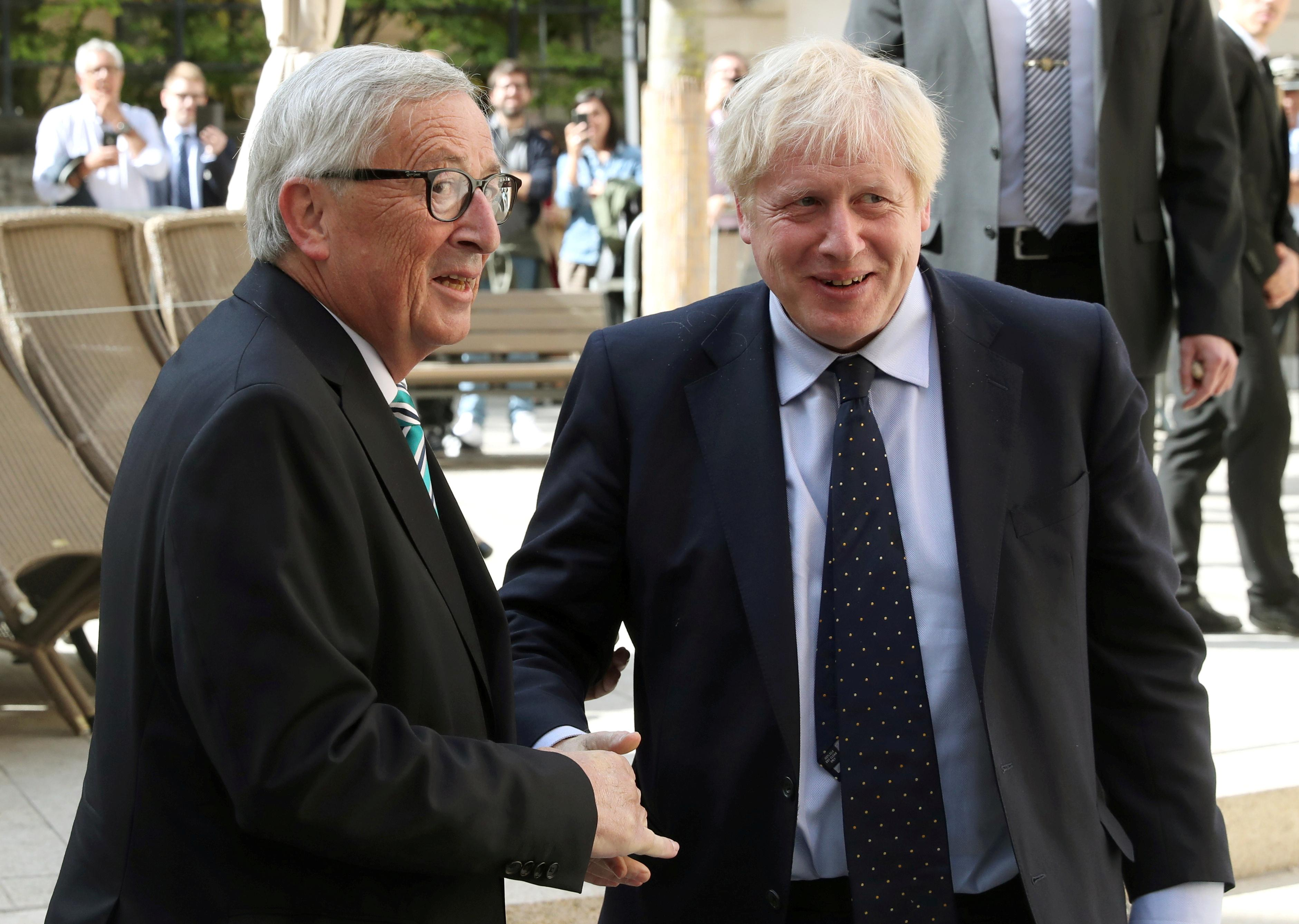 Johnson buffeted in Luxembourg, says Brexit deal emerging