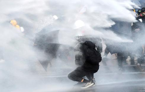 Petrol bombs and water cannons in weekend Hong Kong protests